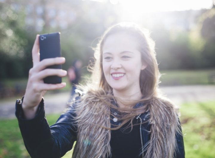 Teenage girl taking selfie – Talking to your teenager about what they've seen online or in the media