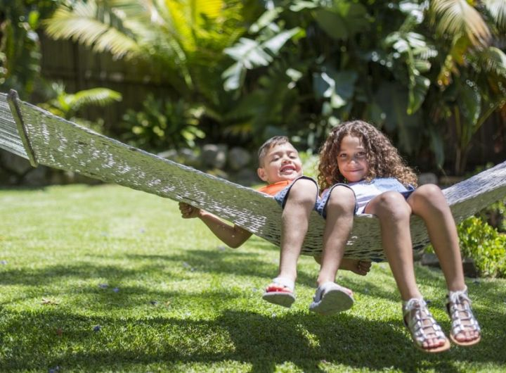boy and girl swinging on outdoor hammock