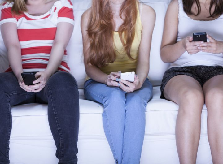 Teenage girls on mobile phones – How to prevent the quest for Facebook friends hurting your kids